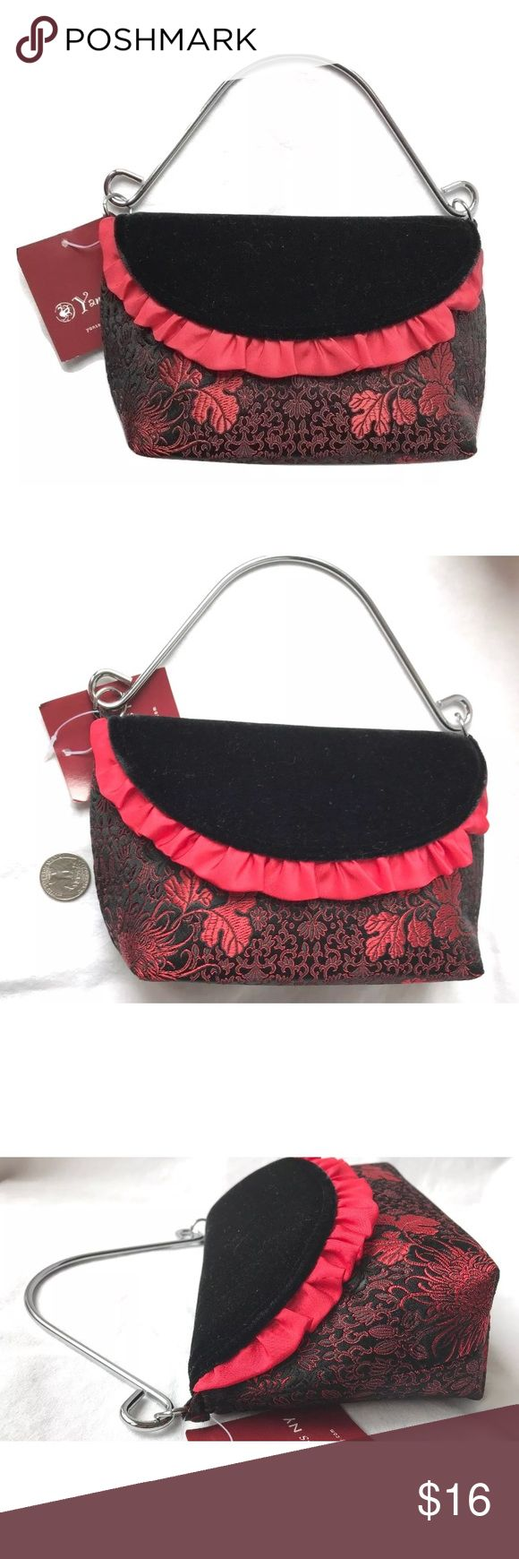 """SMALL Asian Inspired Evening Handbag Super pretty little handbag  The fabric is an faux Asian inspired silk brocade - the fabric is actually 65% rayon & 35% silk  It has a hidden magnet, magnetic flap over closure in a faux velvet, with a ruffle trim  There is a single metal carry handle in a silver tone  Measures approximately 7"""" across, 5"""" top to bottom, bottom width depth is 2.5"""", the carry handle drop is just shy of 4""""  65% Rayon, 35% Silk Made in China  Thank you so much! Yans NY Bags…"""