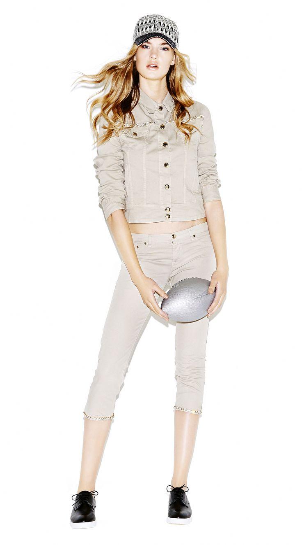 Model wears Naughty Dog denim jacket; a pair of matching capri pants and a baseball cap with glitter peak and geometrical print.
