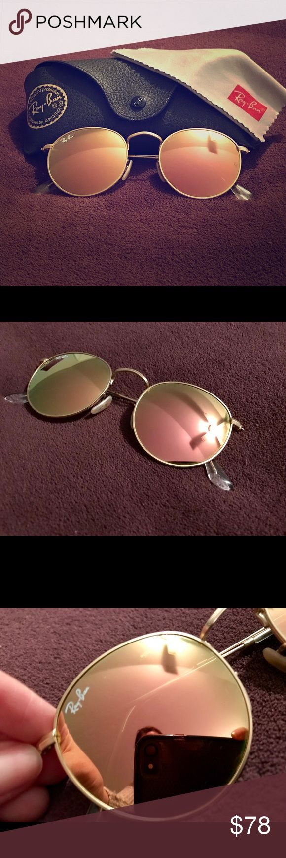 Ray-Ban Sunglasses Round Rose Gold Lenses Round Ray-Ban Sunglasses with Rose-gold lenses in mint condition! No scratches and comes with case and wipe cloth. RB 3447 Round Metal 50 Ray-Ban Accessories Sunglasses
