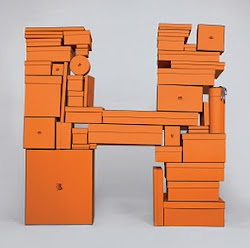 Letter H.  Hermes boxes.  Everyday Object Alphabet type photography by Austrian photographer Bela Borsodi