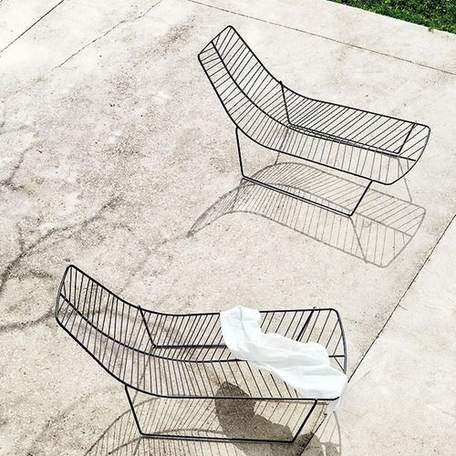 probably not too comfy, but beautifully sculptural lounge chairs  thesetingstaketime