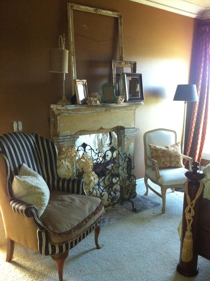 Faux fireplace with antique mantle decorating ideas for Decorate old fireplace