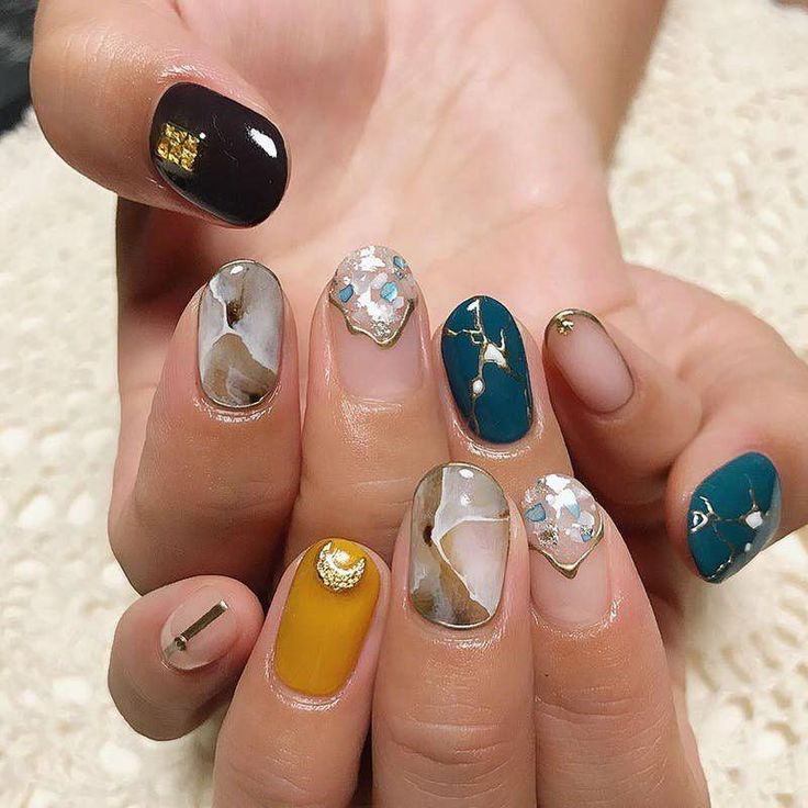 It doesn't get cooler than this creative mixed metals marble nail art design. #n…