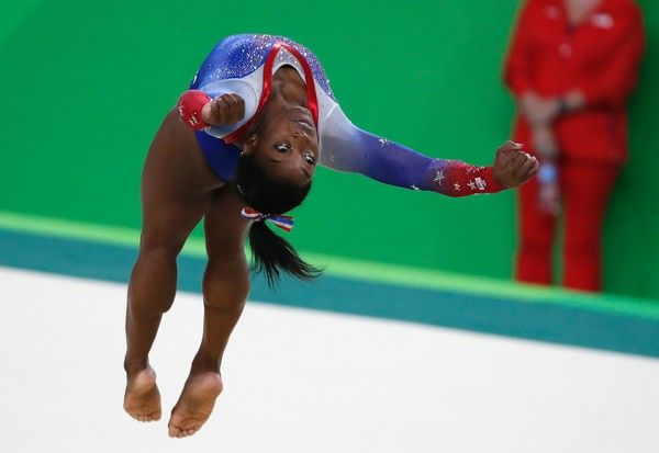 US gymnast Simone Biles competes in the women's floor event final of the Artistic Gymnastics at the Olympic Arena during the Rio 2016 Olympic Games in Rio de Janeiro on August 16, 2016. / AFP / Thomas COEX