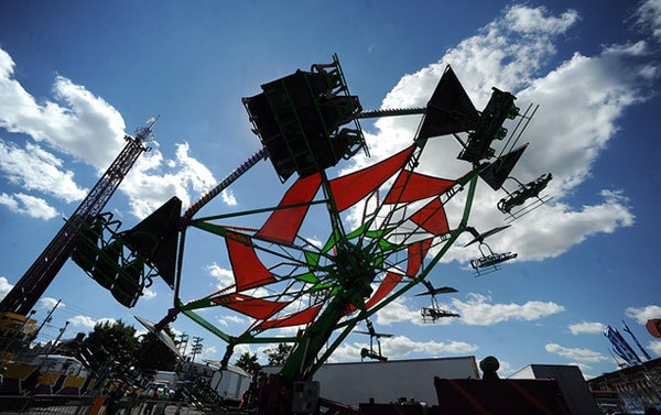 Thrill seekers ride the Cliff Hanger on the midway during the Great Allentown Fair Wednesday afternoon.