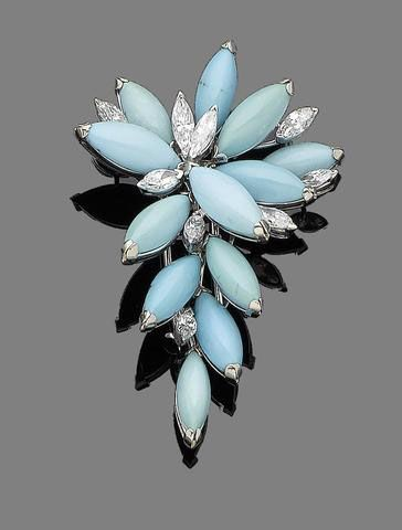 A turquoise and diamond brooch Of foliate design, set throughout with navette-shaped cabochon turquoise, highlighted with marquise-cut diamonds