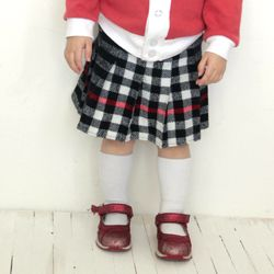 Take an unworn scarf and turn it into a swingy pleated skirt for a little girl.