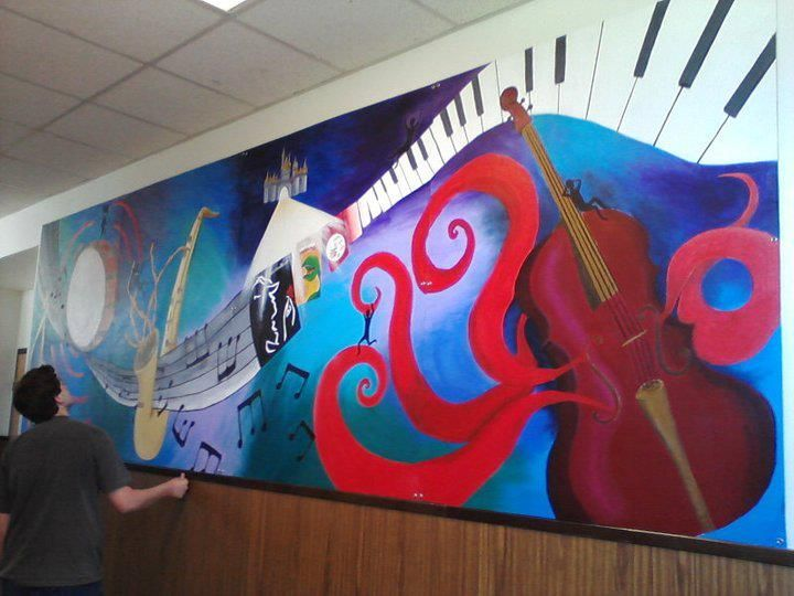 Three of my friends and I designed and painted this mural for the drama/music hallway of our high school. It is 5 feet tall, 16 feet long, and took us 9 months to complete. Every two years the hs b...