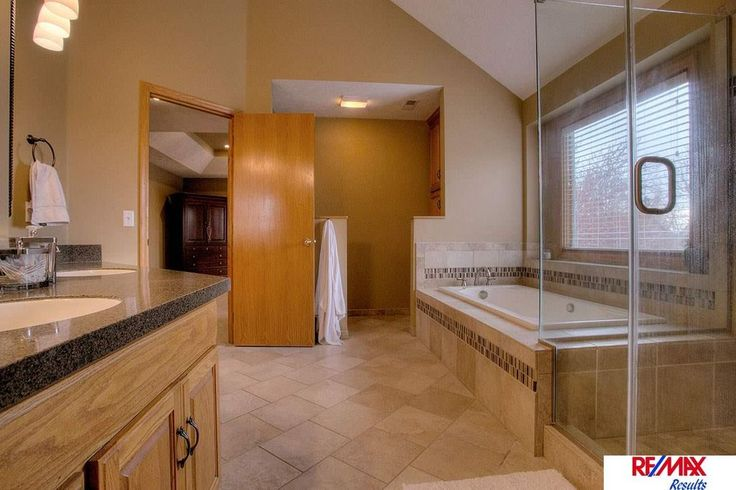Contemporary Full Bathroom with Frameless Shower Doors By Dulles Glass and Mirror, Nova Brown Granite, Radford Cabinets