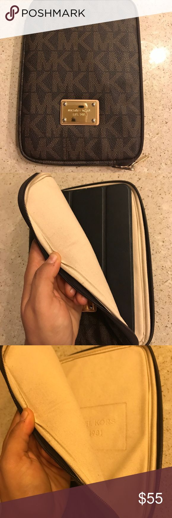 Michael Kors IPad mini sleeve Perfect condition! Brown with gold hardware. A few small scratches on the Michael Kors badge on the front. Inside is perfectly clean! Fits an iPad mini 1st generation Michael Kors Accessories Tablet Cases