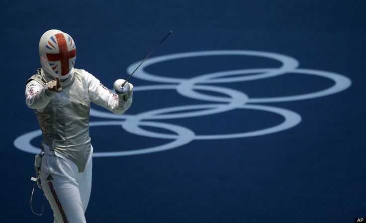 Anna Bentley of Great Britain reacts during her match against Monica Peterson of Canada during the round of 64 for women's fencing at the 2012 Summer Olympics, Saturday, July 28, 2012, in London. Bentley won.