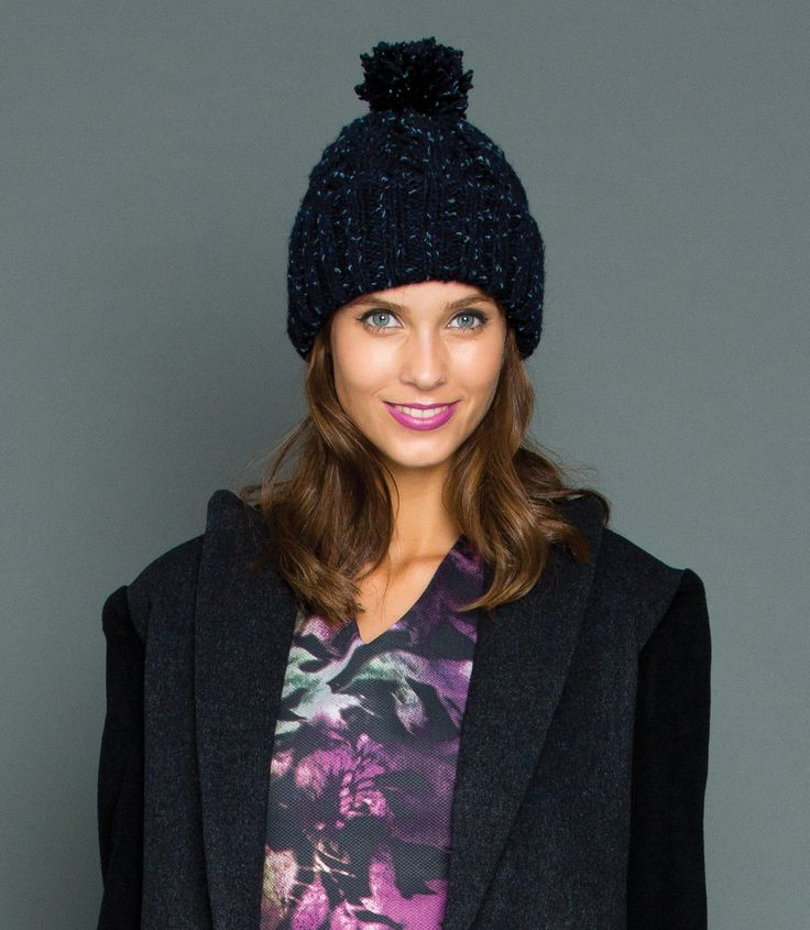 Our Pom Pom Beanies are hand knitted from 100% Wool. Navy in colour with a subtle aqua and royal blue flecks. Super thick to keep you snug this Winter but also super cute!