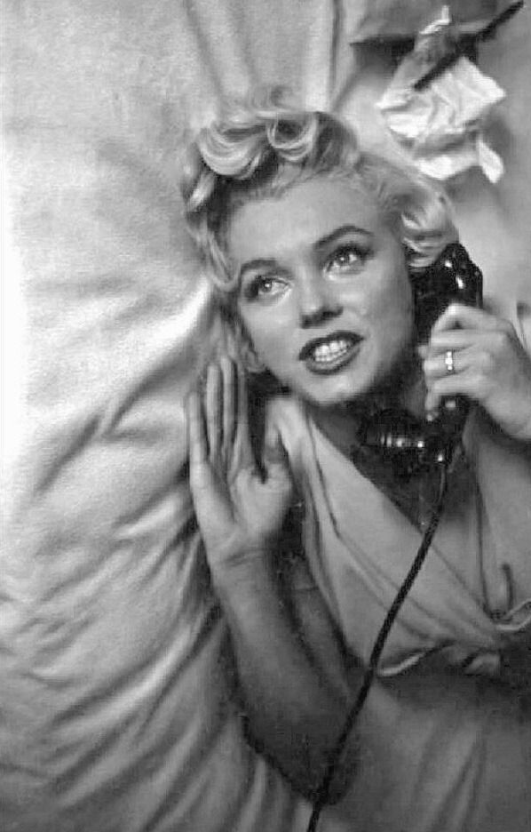 When you browse informal photos of Marilyn Monroe, there are three recurring themes: she's often in bed, napping, lounging, daydreaming; two, there's always a drink at hand; and three, she's on the phone a lot—a lot. I bet that in this age, she'd...