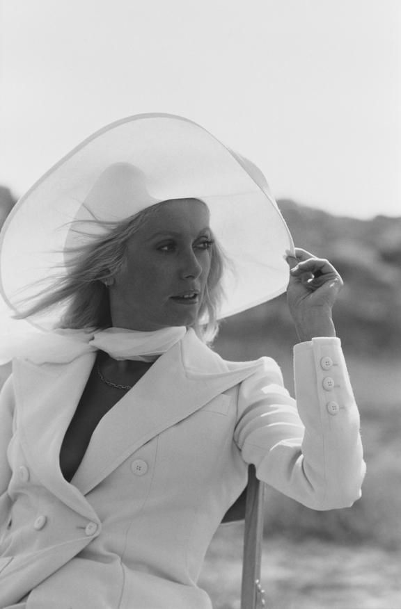 Catherine Deneuve wearing Yves Saint Laurent on the set of Liza (directed by…