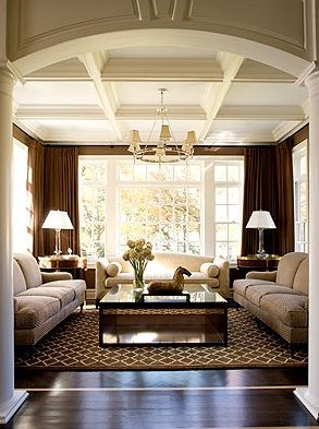 Lovely living Room. Love the deep rich color on the walls with the striking contrast to the Beautiful white coffered ceiling