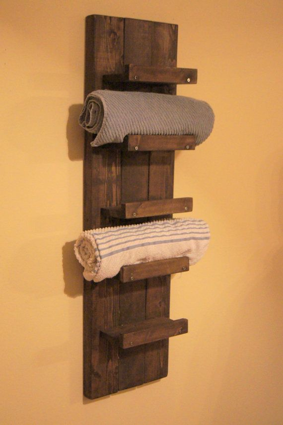 5 tier towel rack shelf. This shelf holds 5 bath size towels, you can also place hand towels, toilet paper, or even decor items on this shelf. The shelf is made from solid pine. It is cut, sanded, stained and has a coat of poly on it. We can stain the towel rack any color you see on the last photo. The shelf measures 39 inches by 10.5 inches wide. Each individual shelf measures 8.5 inches long, 3.5 inches deep and has a gap of 6 inches between shelves.