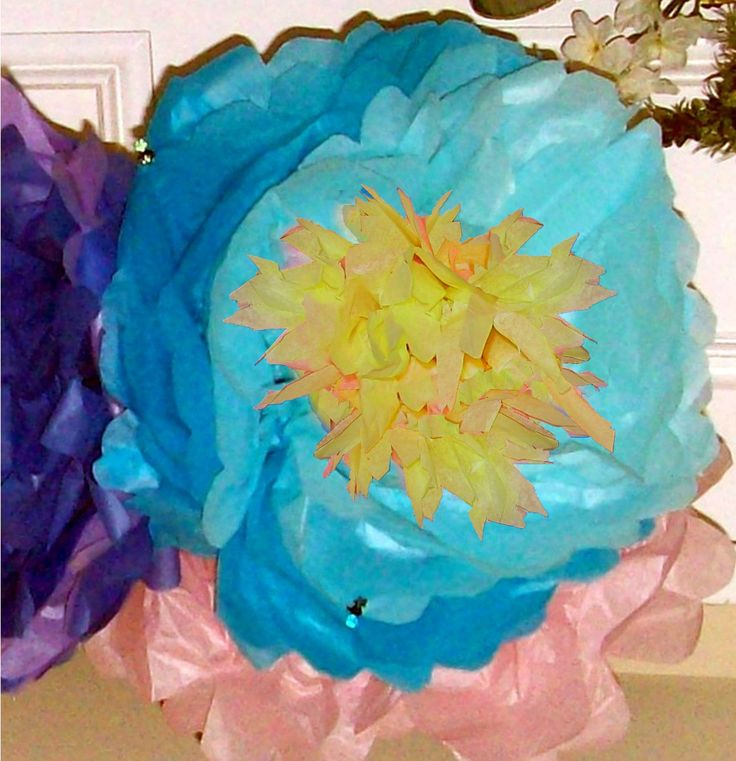 A la 1960's, 2 colour blue, tissue paper flowers with yellow centre  for Sienna's 5th birthday