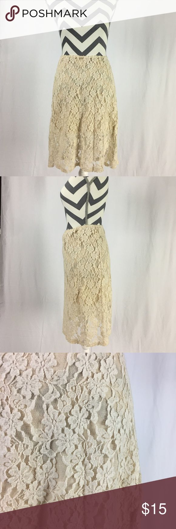 Lace Midi Skirt Below the knee lace romantic skirt. Interior lining stops above the knee. Off white color. Size large. Purchase from Apricot Lane Boutique (Peoria IL). 100% polyester. Hand wash in cold water. Hang to dry. Jella Couture Skirts Midi