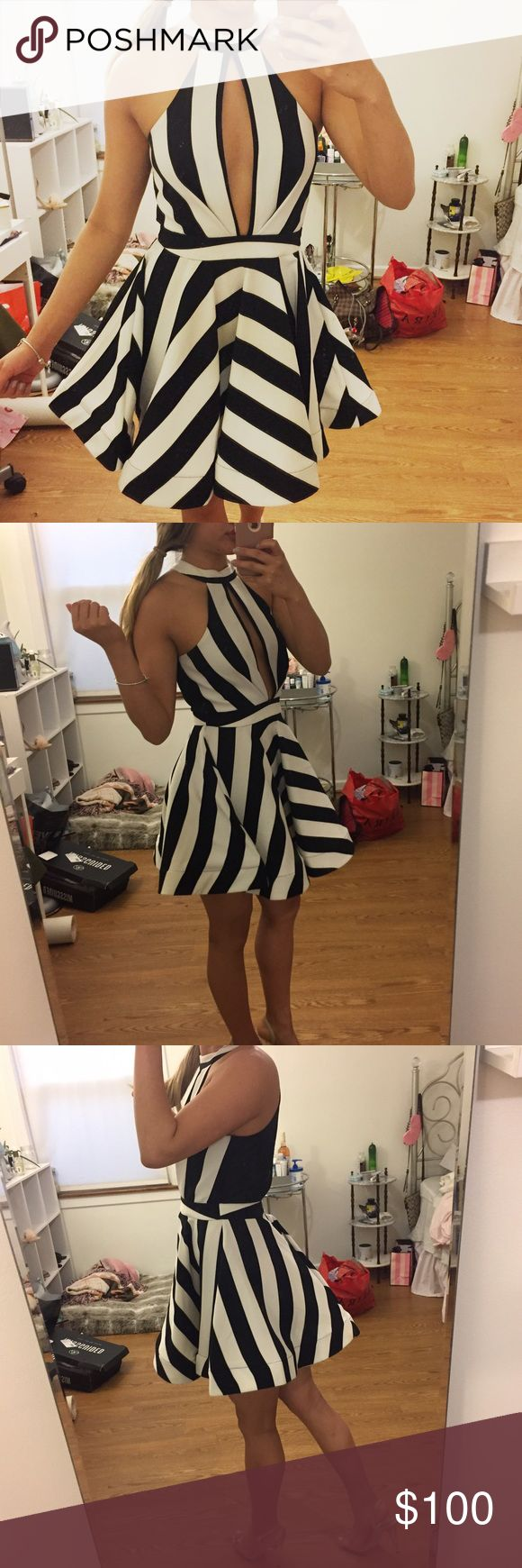 Black and White Stripped cocktail formal dress Amazing condition never worn bought from a boutique in South Beach Miami. No brand. This dress is fabulous and beautiful. I just never had anywhere to wear it ever. BCBG Dresses Midi
