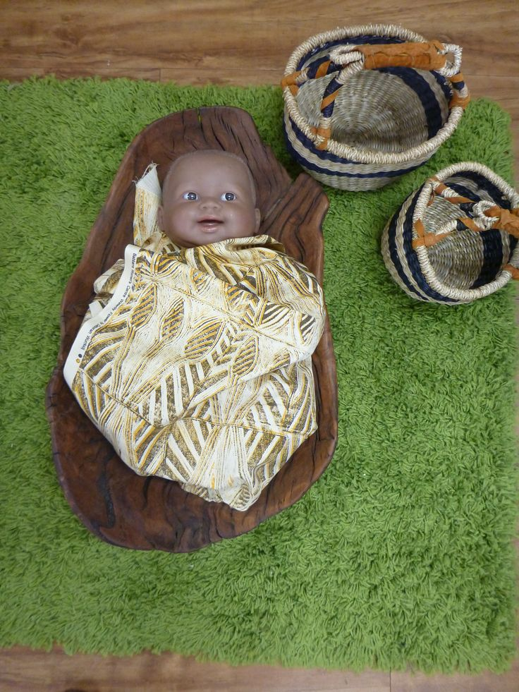 Thinking about traditional indigenous child rearing - baby doll in coolamon in home corner at Pied Piper Preschool
