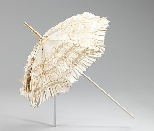 """""""Parasols, such as this, reached miniature sizes in the 1850s and 1860s. Coincidentally, the size of hats at this time was also small. This parasol was a frivolity which served no function but acted as an adornment around the head, serving the purpose of a large hat. This piece is special, for fewer parasols from this period exist in museums than from the 1870s onward."""""""