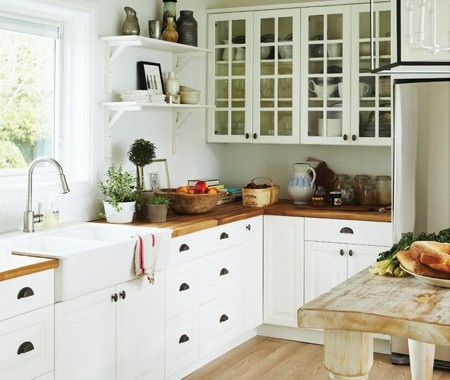 I think this is what I will go for when I replace my kitchen. Ikea kitchen with Adel cabinets, wooden countertops, and Domsjo sink. Fagleboda hardware.