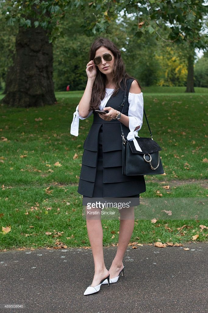 Fashion blogger Sylvia Haghjoo wears Opening Ceremony at The Outnet dress, Sam Edelman shoes, Acne sunglasses, Zara top, Chloe bag, and Yves Saint Laurent jewellery on day 4 during London Fashion Week Spring/Summer 2016/17 on September 21, 2015 in London, England.