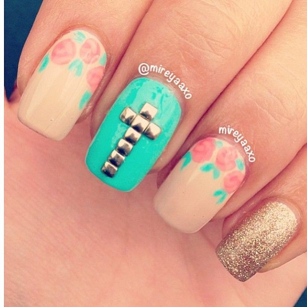 Love the flowers on the bottom of the nail, but the cross is a little off on proportions. Smaller studs or just painted on would be better!