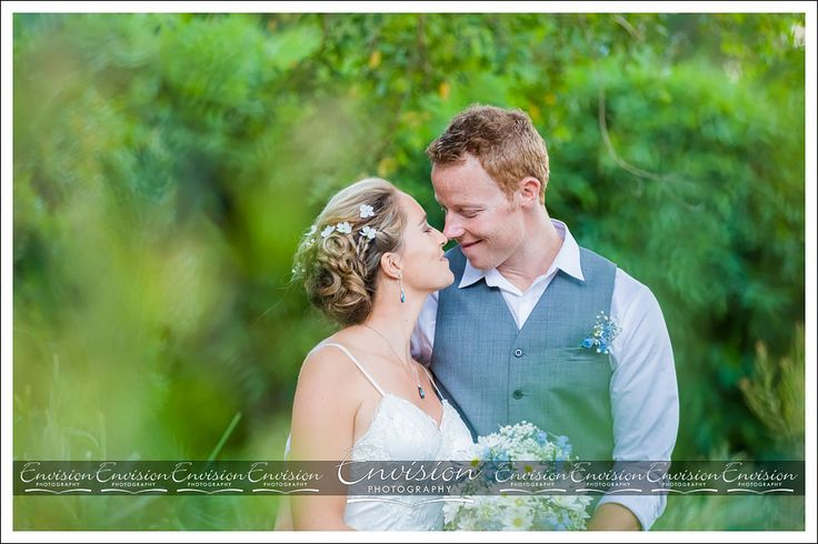 Reychelle and Ryan sharing a specail moment on their wedding day at the Botanical Gardens Hervey Bay