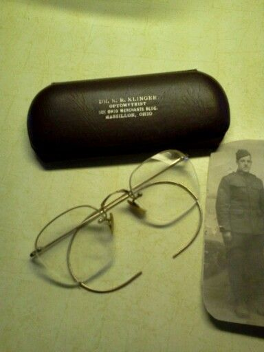 My Dad's glasses WWI photo of him in his uniform. I am very proud of him.