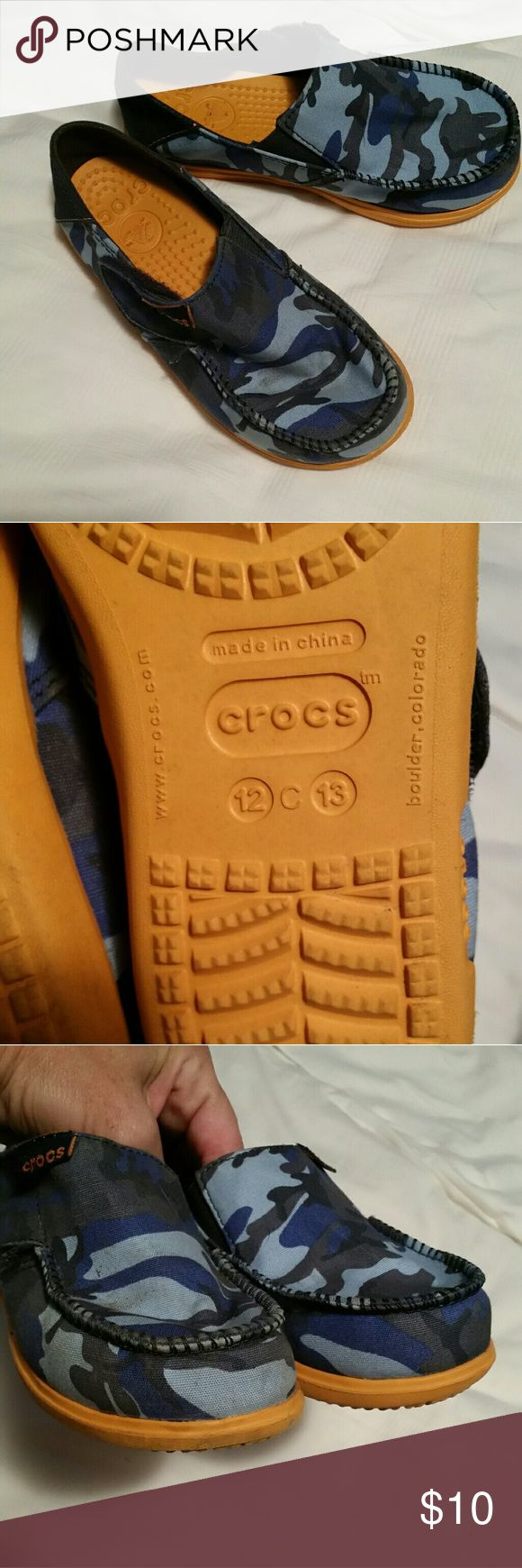 Crocs kids blue camo shoes In great condition. Velcro on the side. The size on the bottom says 12 13. CROCS Shoes