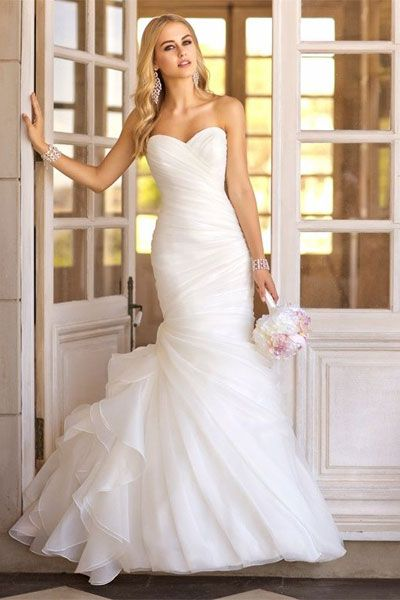 Stella York  trumpet;  asymmetrical Organza pleats throughout its beautiful bodice and skirt, while fun and flirty gathered fabric on the side hints at vintage charm to truly make these trumpet wedding dresses shine.