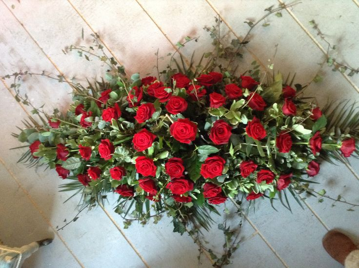 Funeral Flowers. Red rose and red carnation funeral spray, coffin spray, casket spray, funeral flowers www.thefloralartstudio.co.uk