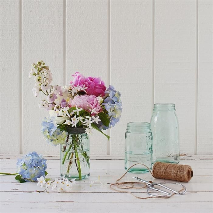 old fashioned mason jar.  Can be used as storage or as a vase $24