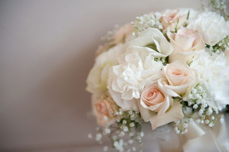Soft peach and white bridal bouquet with baby's breath, roses ...
