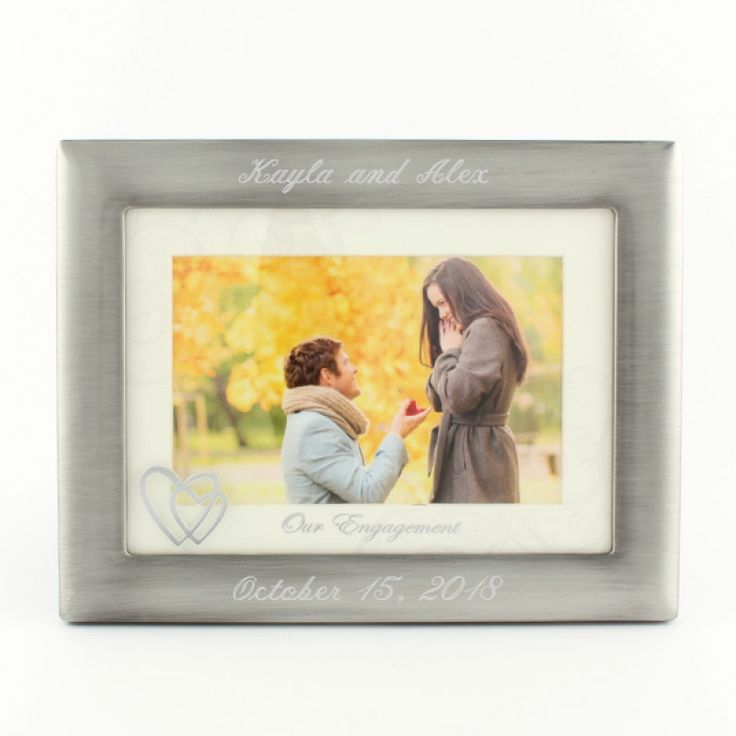 """4x6 Engagement Frame Brushed Silver w/Matt - He asked and you said yes! Your engagement is a special time and this frame is the perfect way to display your favourite photo! Photo opening is 6x4 and it includes a decorative photo matt with """"Our Engagement"""" written on it. The bottom left corner of the glass also includes a two heart decal that is the perfect touch."""