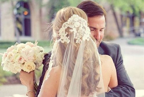 What about using your applique from the belt across the top of your veil if you don't use it with the dress? You could still have a hair decoration that you slip in when you take the veil off