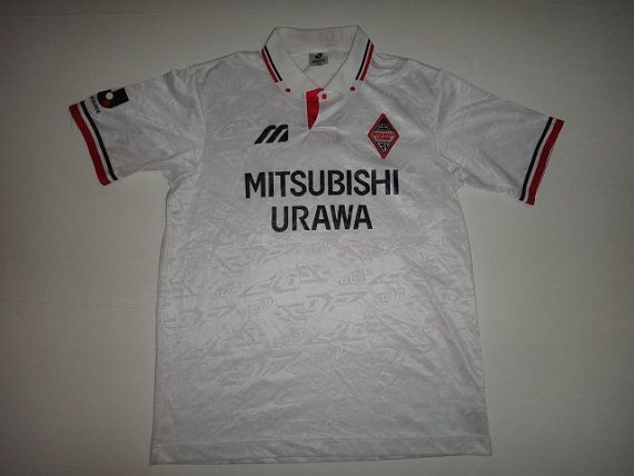 Check out this item in my Etsy shop https://www.etsy.com/listing/231509321/vintage-urawa-reds-diamond-jersey-soccer