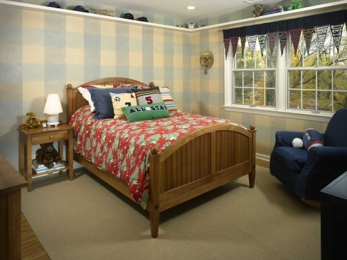 this soft blue gingham patterned wall covering gives this bedroom a distinctly country feel