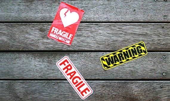 carrier, ruggage sticker. Fragile, Warning.
