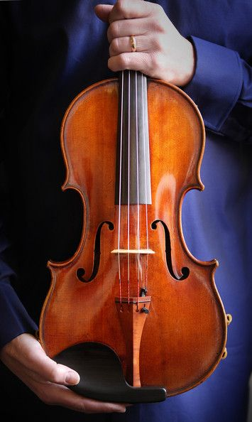 Learn to play the viola (This is a Stradivarius viola, one of the most rare instruments in the world.) Another beautiful intrument!!