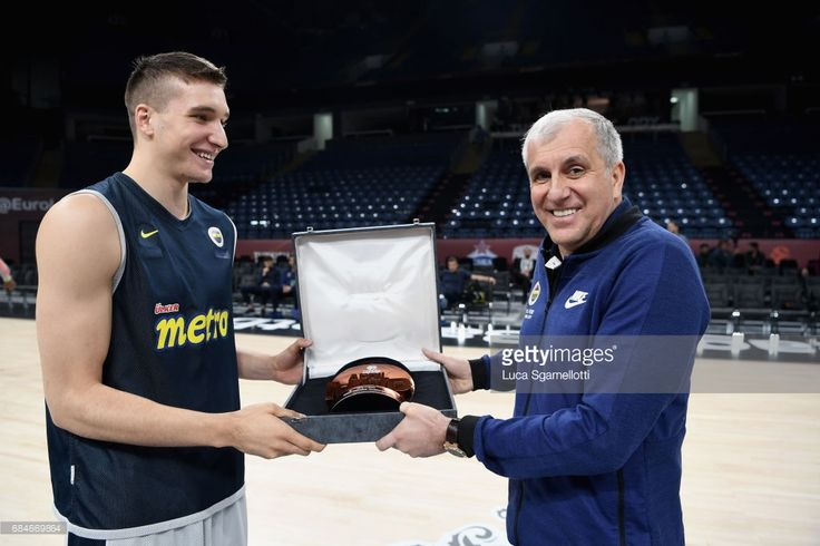 Bogdan Bogdanovic, #13 of Fenerbahce Istanbul recives the April Euroleague MVP from his Head Coach Zeljko Obradovic during the 2017 Turkish Airlines EuroLeague Final Four Real Madrid Practice at Sinan Erdem Dome on May 18, 2017 in Istanbul, Turkey.