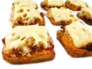 Skinny Mini Reuben Appetizers, Low Calorie and Delectable! A classic deli sandwich turned into a bite-sized appetizer. Each has only 61 calories, 2 grams of fat and just 1 Weight Watchers POINTS PLUS! Get ready for rave reviews. Everyone loves them! http://www.skinnykitchen.com/recipes/low-calorie-and-delectable-skinny-mini-reuben-appetizers/
