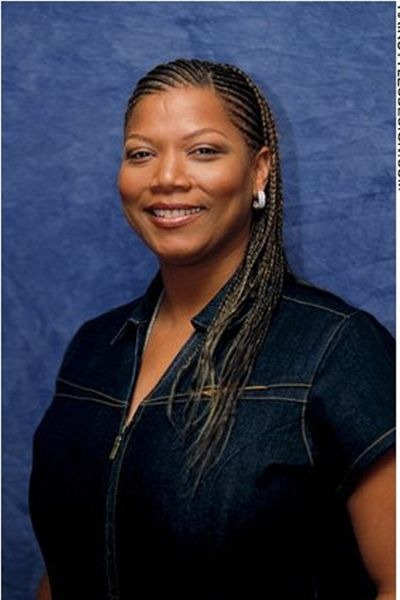 Queen Latifah has her hair completely styled in cornrows. Her black hair is tightly braided leaving no hair out of place. The overall look is clean and this is definitely a neat appearance.Her hair is cut very long.The black hair coloring is perfect for her complexion.
