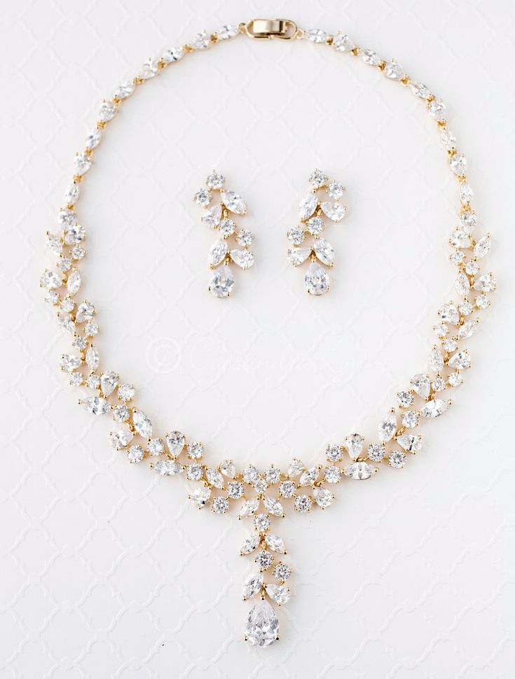 Round, teardrop and marquise CZ jewels form this lovely bridal necklace design. Earrings are approximately 1.5 inches long, post backs, the necklace is 16 inches with a locking clasp.