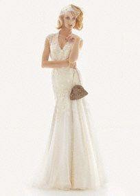 Airily romantic fit-and-flare wedding gown with intricate dressmaker detailing.   Exquisite corded lace is hand-applied in three-dimensional floral pattern over tulle overlay.  Gown features accents of hand-cut satin fabric and ribbon embroidery.  Illusion net at the neckline adds a romantic, ethereal touch.  Modern cap sleeves present an elegant alternative to a strapless neckline.  Skirt layered in tulle and crinkle chiffon adds airiness and dimension.