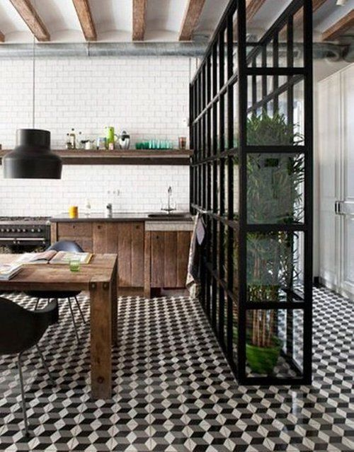 """""""Green"""" kitchen with reclaimed wood cabinets and table and atrium."""