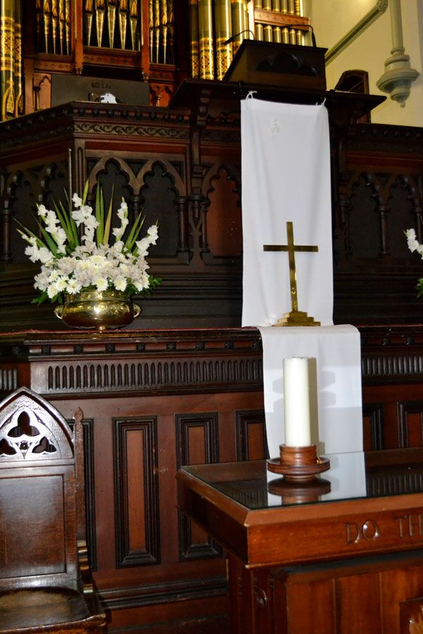 The wood carvings around the pulpit, choir and communion area were the work of a Mr Bennett in 1888 for the ALbert Street Uniting Church, Brisbane.
