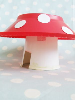 Mushroom fairy house, made from a plastic bowl and paper cup. dollar store craft!