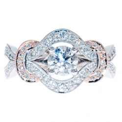KLARA - ORNATE WHITE AND ROSE GOLD DIAMOND ENGAGEMENT RING  Graceful curves are used to great effect in this captivating, highly detailed engagement ring. Diamond set rose gold features add a rosy accent to the unparalleled brilliance of the bejewelled white gold.